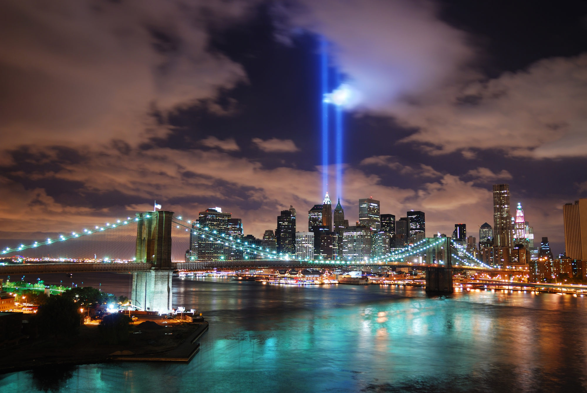 A view of Manhattan from over the Hudson River, with two light beams in memory of September 11. Photo © Songquan Deng | Dreamstime.com