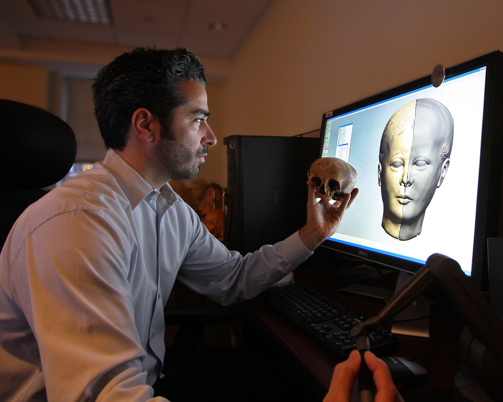 Forensic artist Joe Mullins works on a facial reconstruction from a partial skull. Photo credit: Robert Bird, courtesy, NCMEC