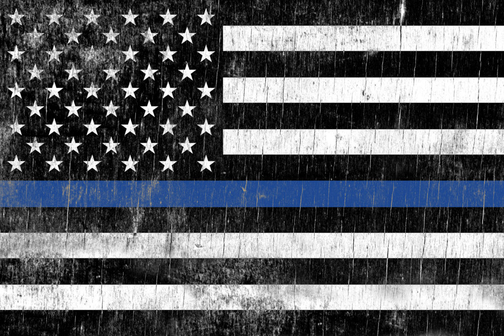 A law enforcement police support flag painted over a cracking wooden texture. © Enterlinedesign | Dreamstime.com