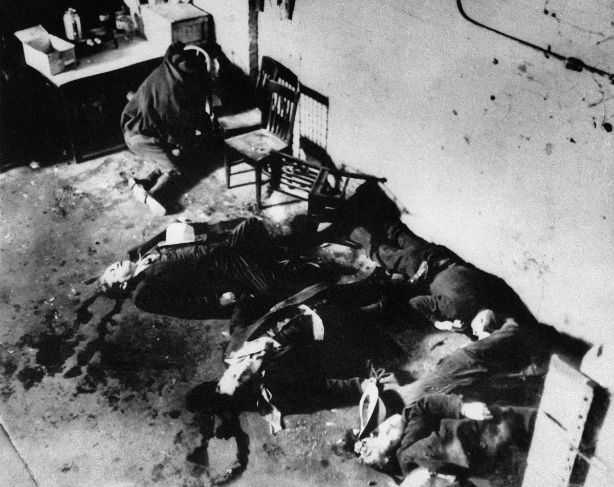 "This Feb. 14, 1929 photo from the Associated Press shows the bodies of six of the seven men who were slain in the ""Valentine's Day Massacre"" gang-shooting in Chicago's North Side. According to Grant Duwe, a criminologist with the Minnesota Department of Corrections who has written a history of mass murders in America, mass killings peaked in 1929 and have dropped in the 2000s."