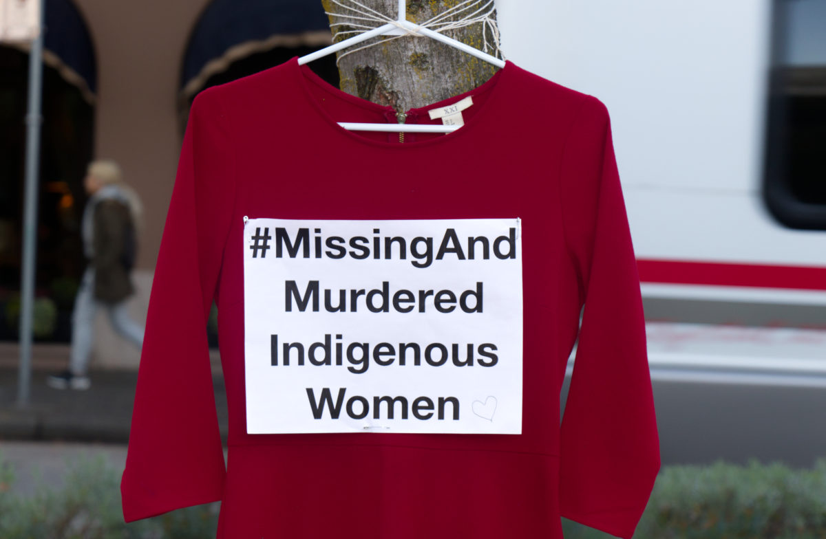 "A red dress with the text ""Missing And Murdered Indigenous Women"" hangs at a Vancouver art memorial to honor Missing and Murdered Indigenous Women in the U.S. and Canada."