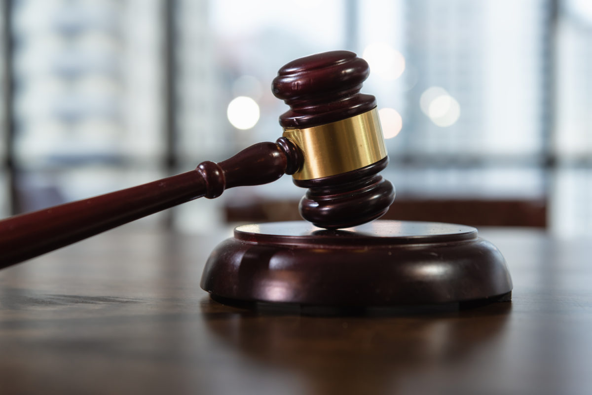 Concept photo of a judge`s gavel on the table © Khwaneigq | Dreamstime.com