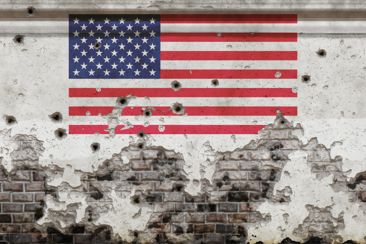 Gun Violence -- bullet holes on an American flag