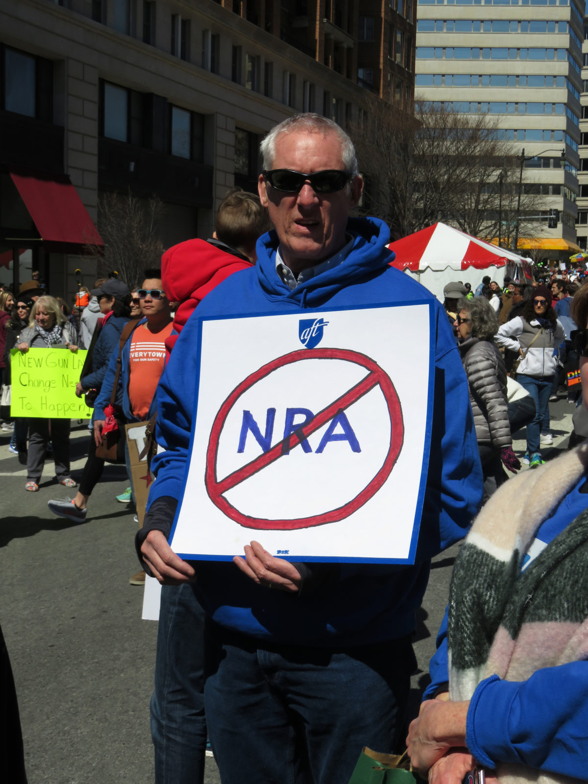 A man holds up an anti-NRA sign at a March For Our Lives rally in 2018. © Richard Gunion | Dreamstime.com
