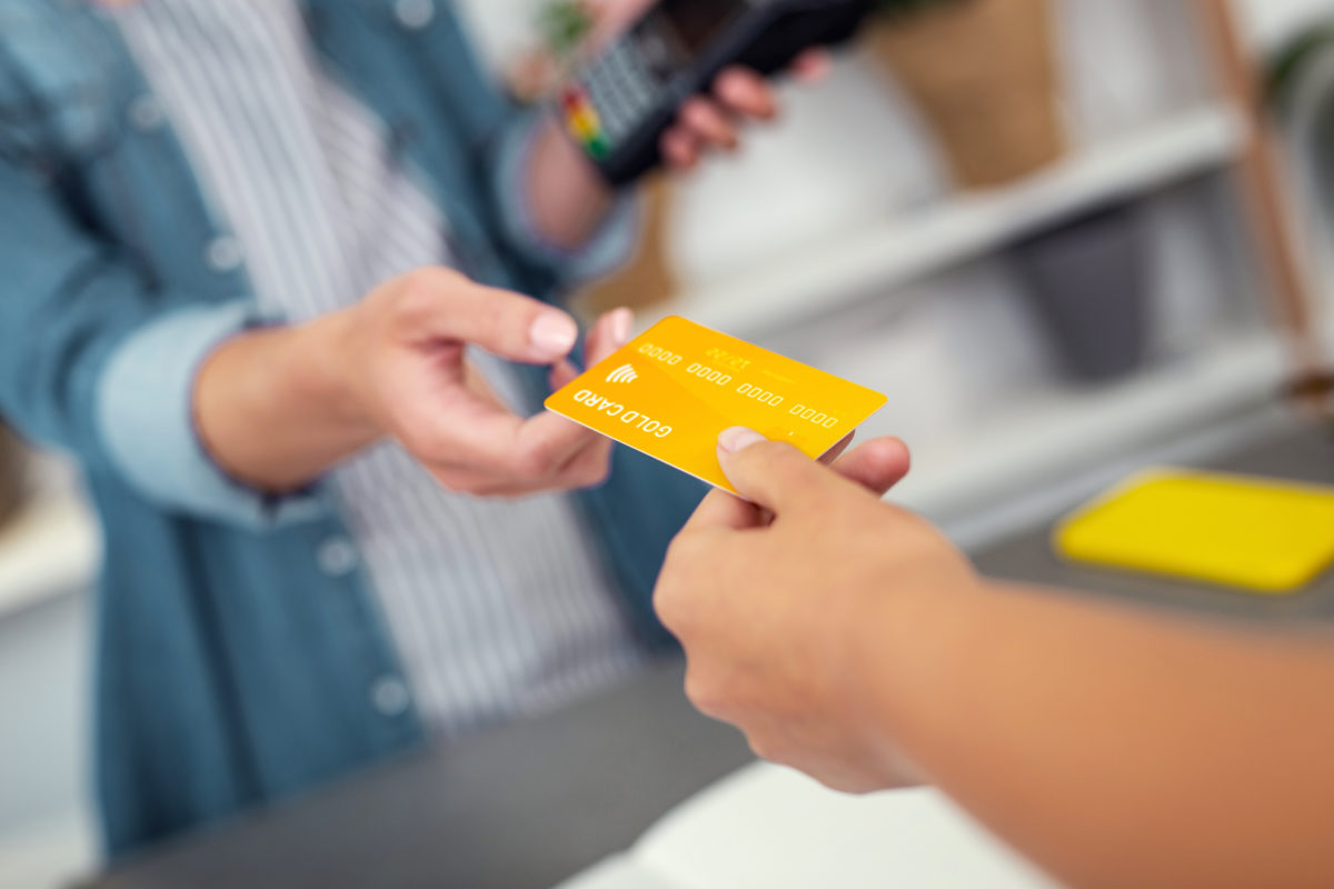 A credit card being presented at the point-of-sale.
