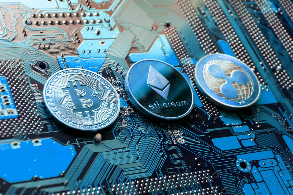 Bitcoin, Ethereum and Ripple coins © Josefkubes | Dreamstime.com