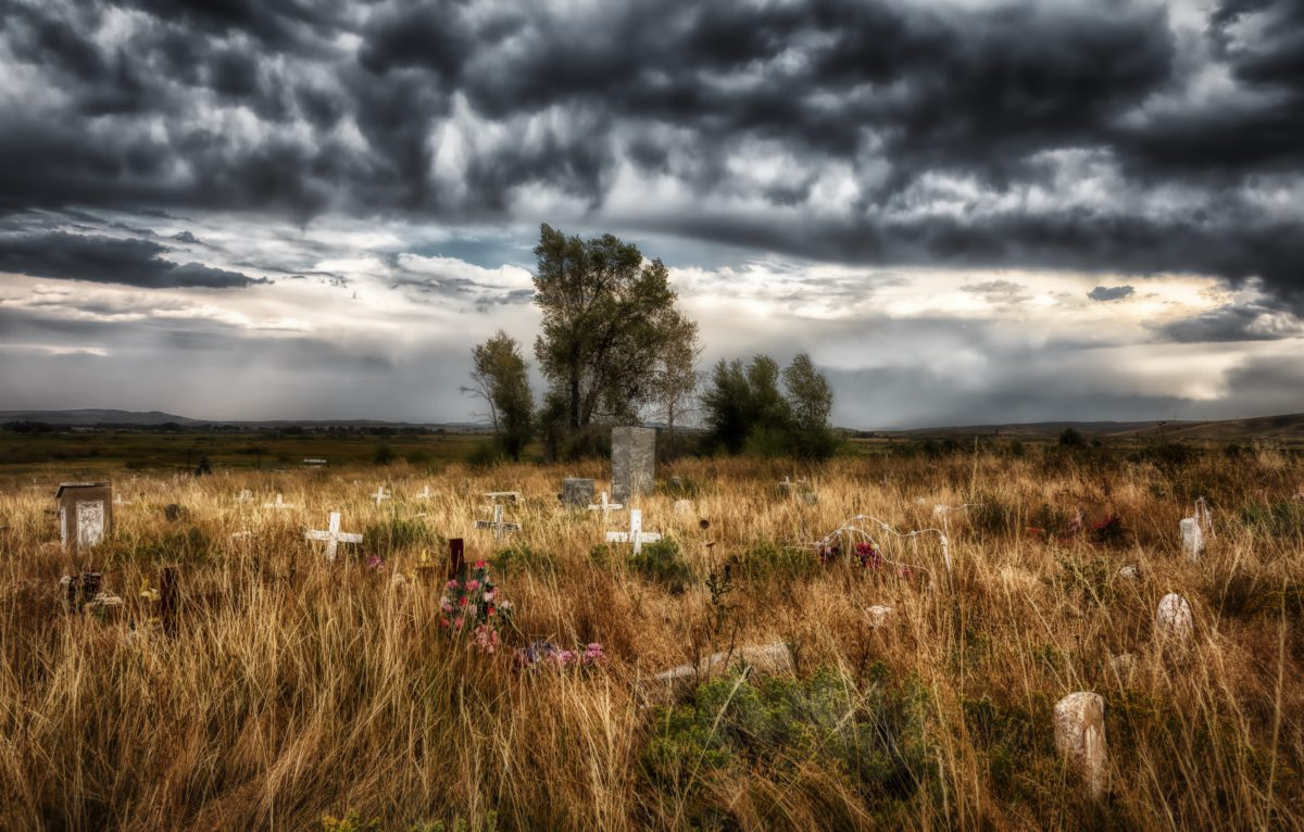 Representative image depicting a cloudy sky over the Shoshone Tribal Cemetery in Wyoming