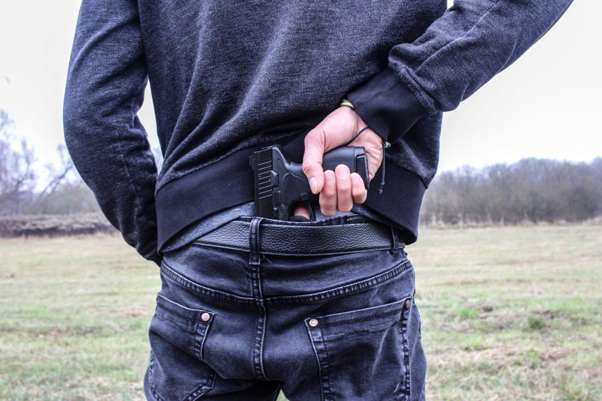 Representative photo of a man holding a gun | Photo by un-perfekt | Pixabay