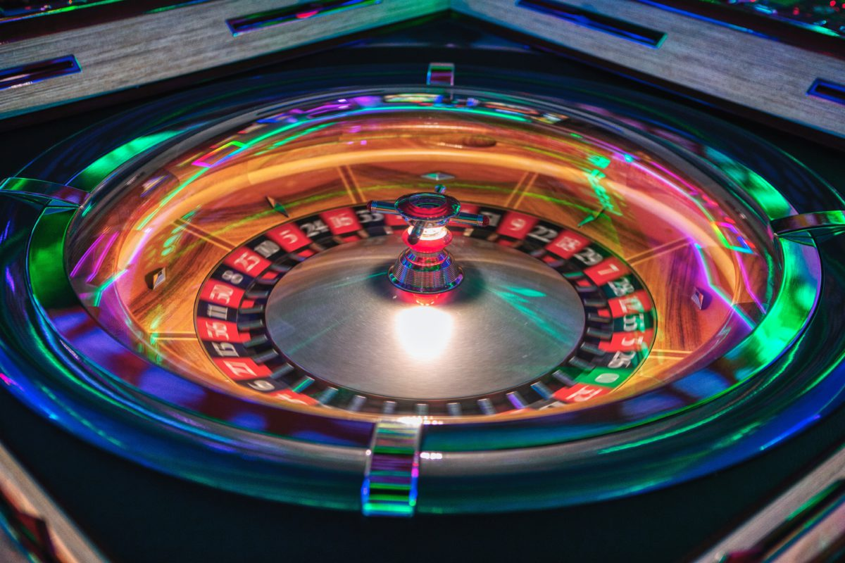 Representative image showing a spinning roulette wheel lit up by neon lights