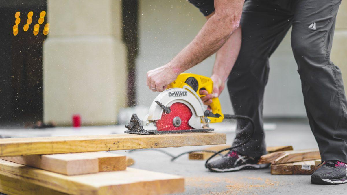 Representative image of a man working on a wooden block | Photo by Greyson Joralemon on Unsplash