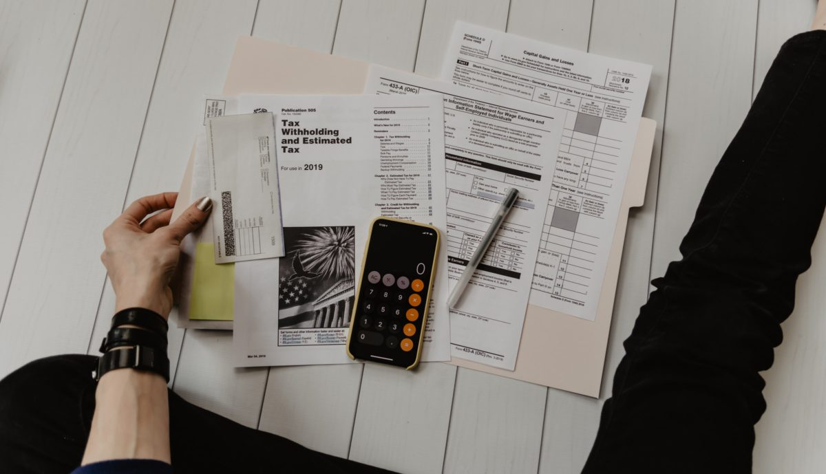 Representative photo of a person doing taxes | Photo by Kelly Sikkema on Unsplash