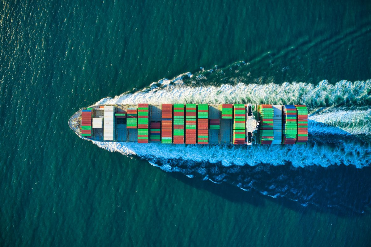 Representative photo of a colorful cargo ship headed out to sea | Photo by Cameron Venti on Unsplash