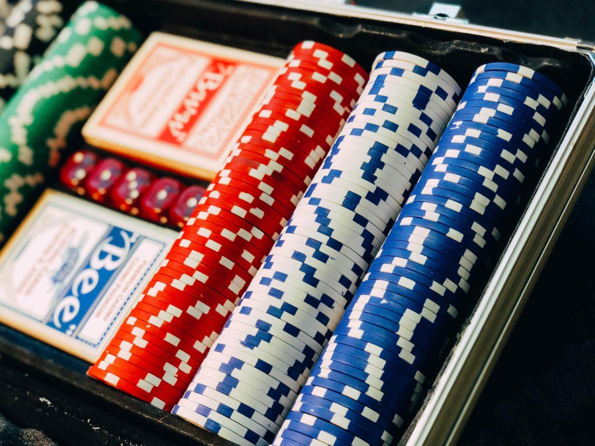 Representative photo of poker chips and cards in a box | Photo by Chris Liverani on Unsplash
