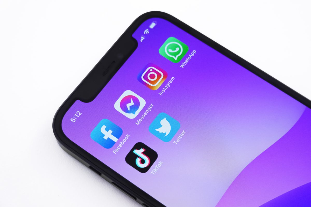Representative image of a phone screen showing the app icons of popular social media platforms
