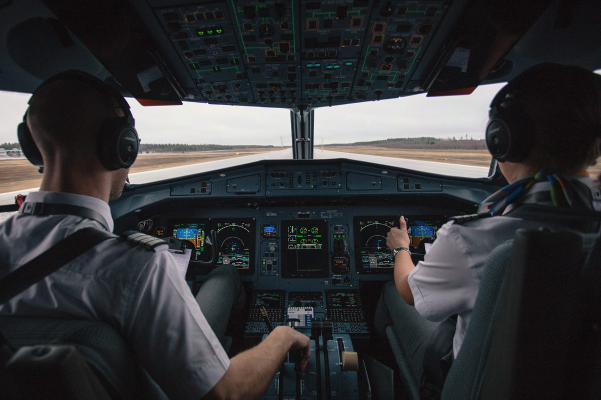 Representative image of the backs of two pilots in the cockpit of a plane