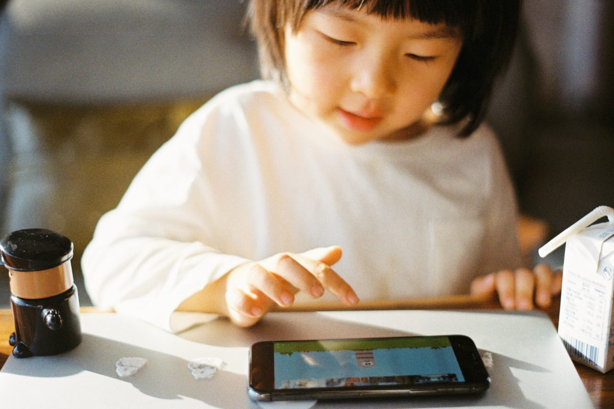 Representative image of a young child playing on an iPad