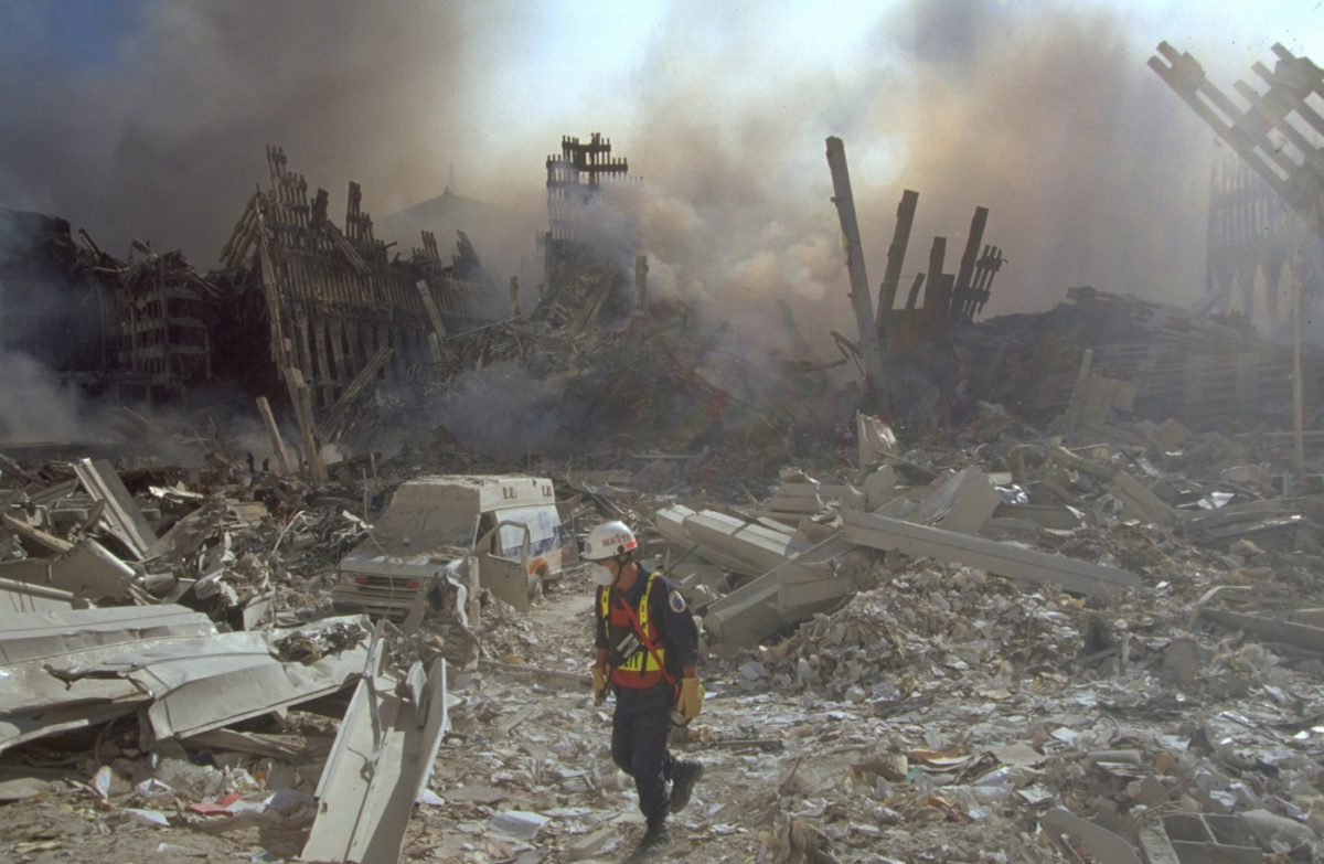 An emergency worker walks amid the rubble of the World Trade Center in Manhattan after the September 11, 2001, attacks | Image Courtesy: FBI
