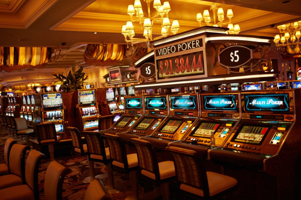Representative photo of slot machines on a casino floor | Photo by Marco Ribbe on Unsplash