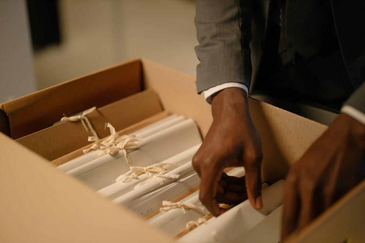 A man rifling through a box of files