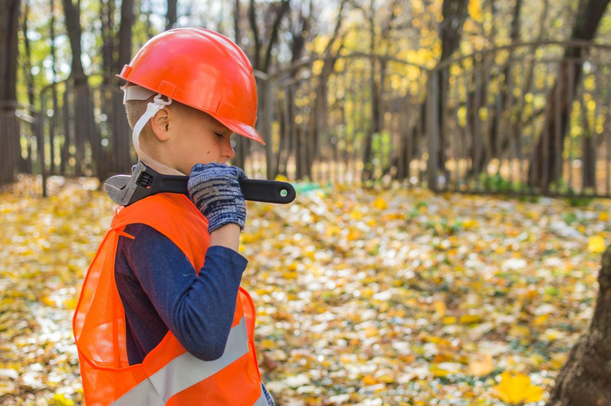 Representative photo of a child dressed in workman's clothes | Photo by Vitolda Klein on Unsplash