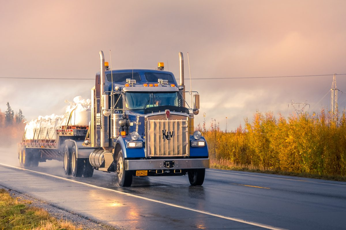 Image of a truck driving down a highway
